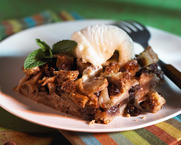 California Raisins Raisin Apple and Wheat Bake on a plate topped with ice crea.