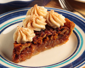 carrot cake pie on plate with whip topping
